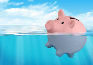 pink Piggy bank sinking savings loss concept